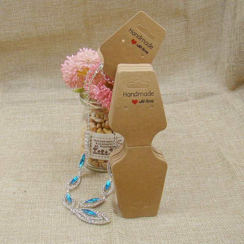 Mẫu in tag bông tai giấy kraft kết hợp với tag dây chuyền
