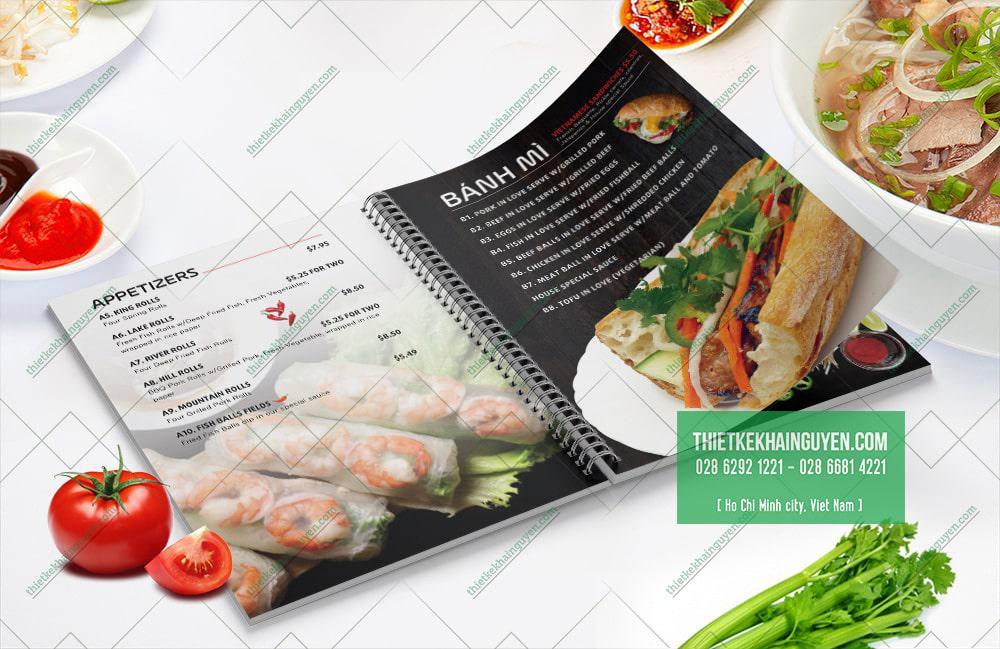 Món gỏi cuốn và bánh mì trong thực đơn nhà hàng Việt